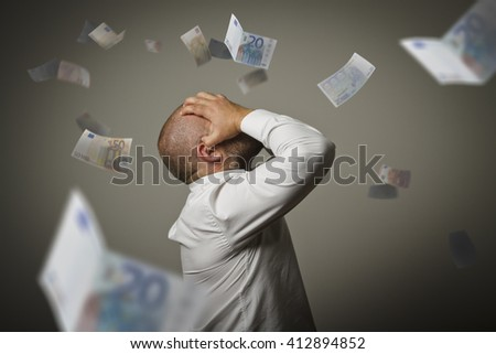 Grief. Man in thoughts and Euro. Business depression and recession concept. - stock photo
