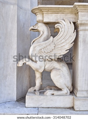 griffin, mythical creature marble statue closeup - stock photo