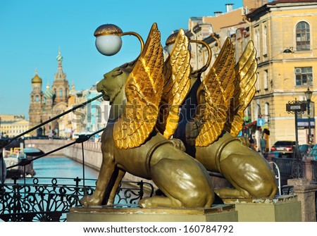 Griffins on The Bank Bridge, St. Petersburg, Russia. Wires in the sky and scratches on griffins's bodies are removed) - stock photo
