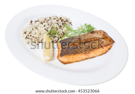Griiled salmon fillet with basmati rice and lemon. Isolated on a white background.