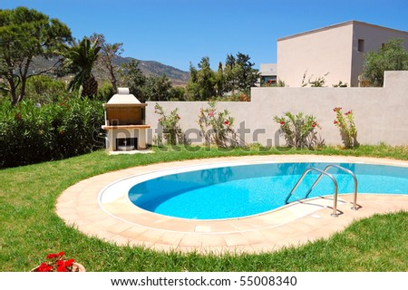 Grill at swimming pool by luxury villa, Crete, Greece - stock photo