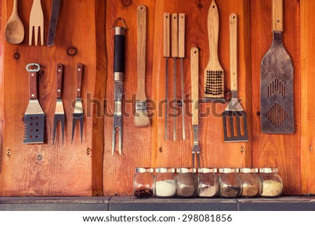 Grill, bbq area with tools hanging on the wall - stock photo