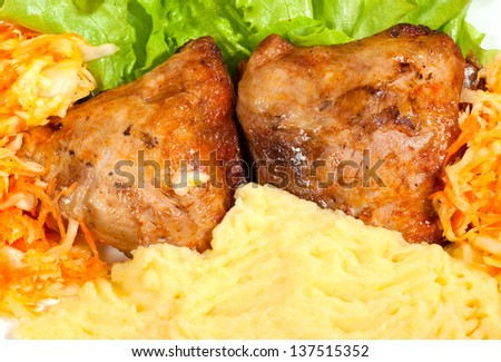 grill chicken with mashed potato and vegetables on a plate.
