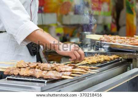 Grill goat skewer is traditional street food in Dali old town, Yunnan, China - stock photo