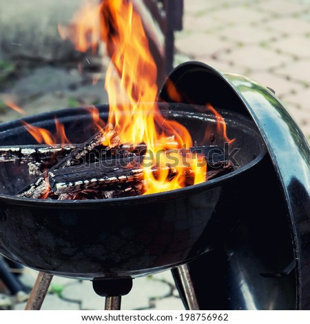 Grill. Hot embers in burning fire. - stock photo