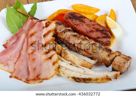 Grill meat mix with potato and tomato
