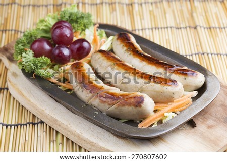 Grill Sausage and vegetables on the metal plate - stock photo