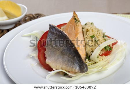 Grilled Arctic Char on Couscous, Fennel and Tomatoes - stock photo