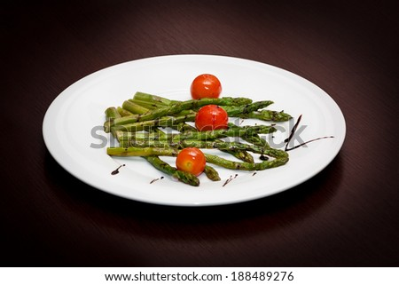 Grilled asparagus with small tomatoes - stock photo