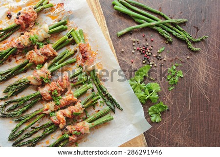 Grilled asparagus wrapped in bacon - stock photo