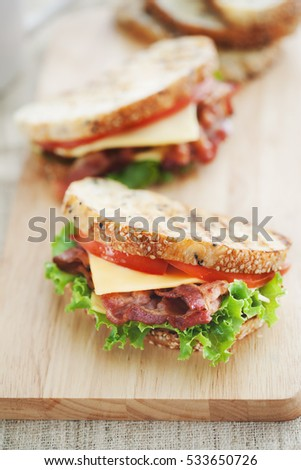 grilled bacon sandwich for meal on wooden board