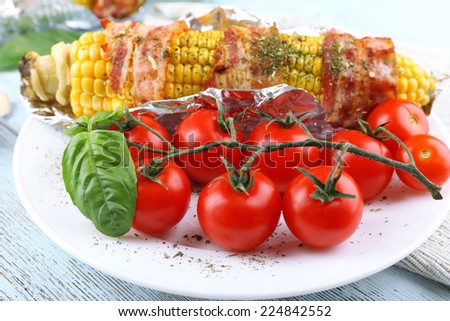 Grilled bacon wrapped corn on table, close-up - stock photo