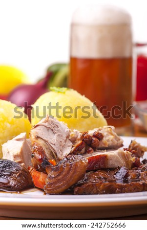 grilled bavarian pork meat with dumplings  - stock photo
