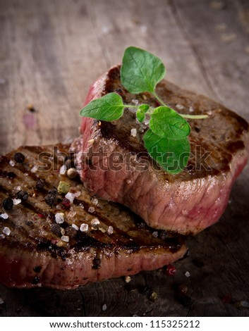 Grilled bbq steaks with fresh herb - stock photo