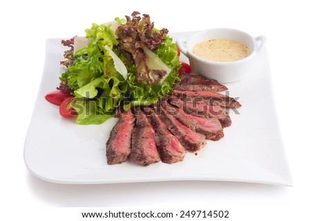 Grilled beef in mayonnaise seafood sauce served with green leaf, isolated on white. - stock photo
