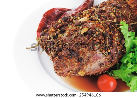 grilled beef in spices with vegetables on white