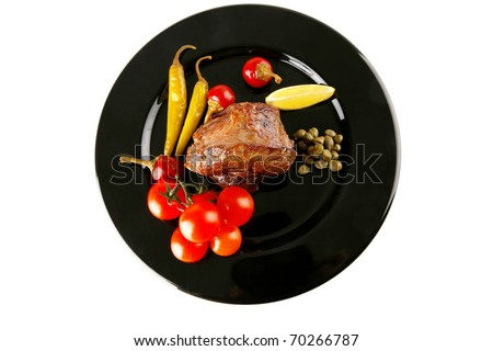 grilled beef meat medallion with  tomatoes on black plate - stock photo