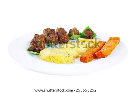 grilled beef meatballs with baked potatoes on white - stock photo