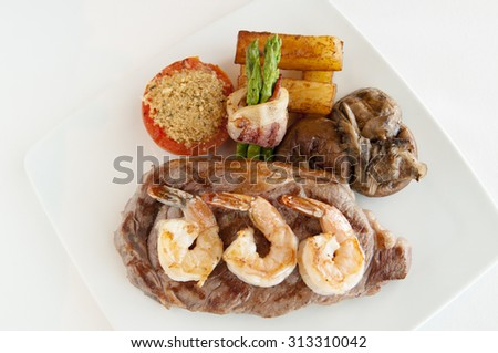 Grilled Beef Steak BBQ. Barbecue Meat Steak with Shrimps fried - stock photo