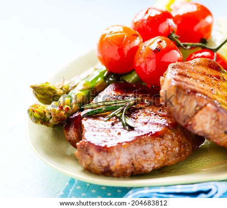Grilled Beef Steak Meat with Asparagus and Cherry Tomato. Steak Dinner. Food. BBQ Grill. Berbeque. Barbecue - stock photo