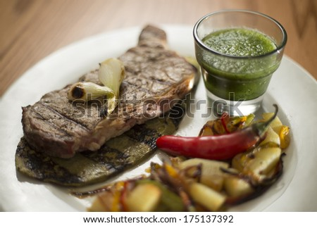 Grilled beef steak served on a cactus, with salsa and vegetables. - stock photo