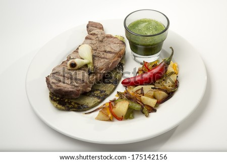 Grilled beef steak served on cactus with vegetables and salsa dip chili decoration top view - stock photo