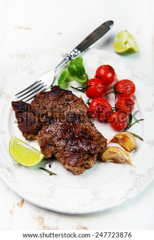 grilled beef steak with cherry tomatoes - stock photo