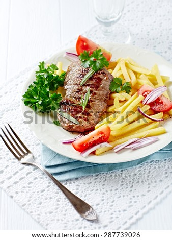 Grilled beef steak with french fries - stock photo
