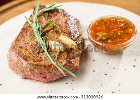 Grilled beef steak with garlic, rosemary - stock photo