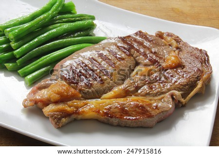 grilled beef steak with green beans - stock photo