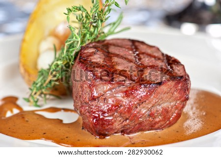 grilled beef steak with herbs and vegetables - stock photo