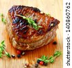 grilled beef steak with pepper and thyme on a wooden board - stock photo