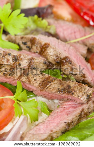Grilled Beef Wraps - Griddled sirloin steak, sliced and wrapped in a flatbread served with blue cheese sauce and salad. Close up. - stock photo