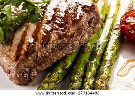 Grilled beefsteak and asparagus - stock photo