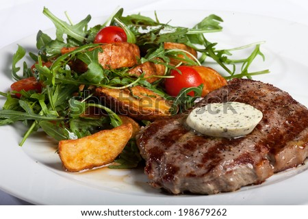 Grilled beefsteak and vegetable salad - stock photo