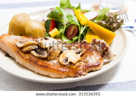 Grilled beefsteak with potato and salad