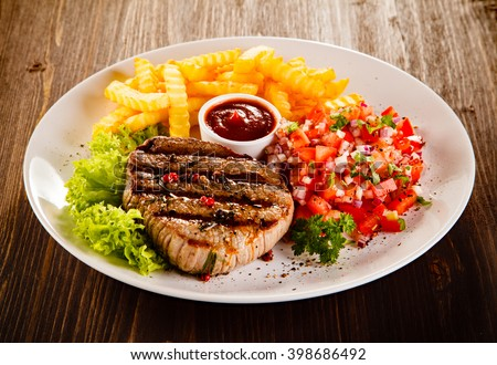 Grilled beefsteaks and vegetables  - stock photo