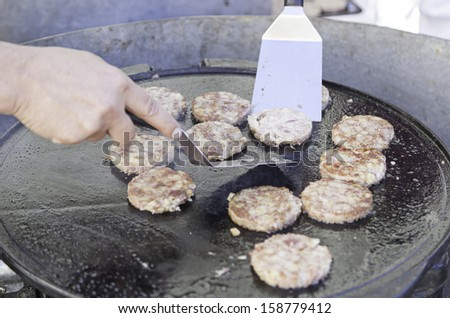 Grilled Burgers iron, detail beef cooked on the grill, American food - stock photo