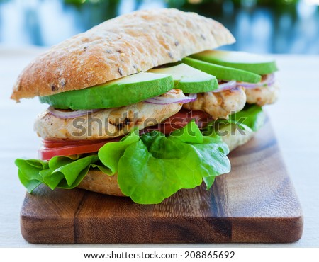 Grilled chicken and avocado sandwich - stock photo