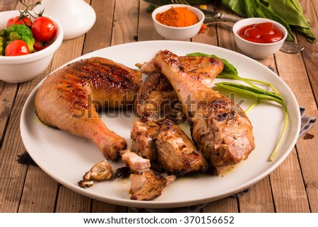 Grilled Chicken and vegetables on white plate. Selective focus. - stock photo