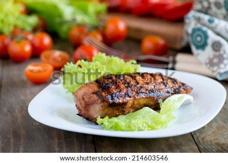 Grilled chicken breast in homemade barbecue sauce