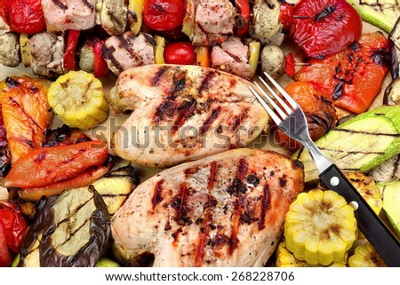 Grilled Chicken Breast, Mixed Vegetables and Fork On Wood Cutting Board Close-Up