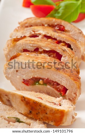 Grilled chicken breast stuffed with basil, tomato and garlic - stock photo