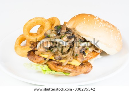Grilled Chicken burger with sauteed mushroom and onions