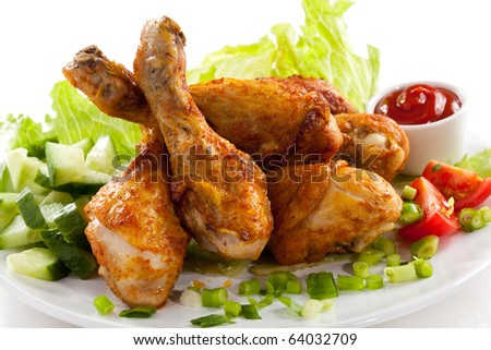 Grilled chicken drumstick and vegetables - stock photo
