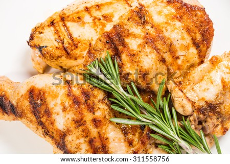 Grilled chicken fillet and legs with rosemary. Macro. Photo can be used as a whole background. - stock photo