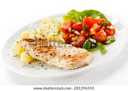 Grilled chicken fillet, boiled potatoes and vegetable salad  - stock photo