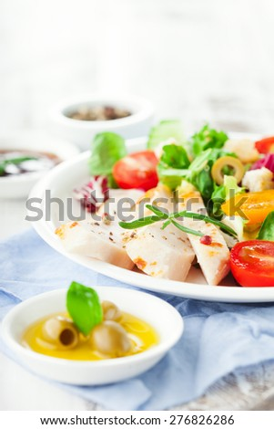 Grilled chicken fillet with fresh vegetable salad on white wooden background, selective focus