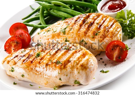 Grilled chicken fillets and vegetables  - stock photo