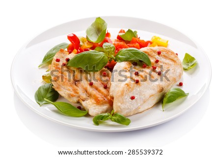 Grilled chicken fillets, rice and vegetables  - stock photo